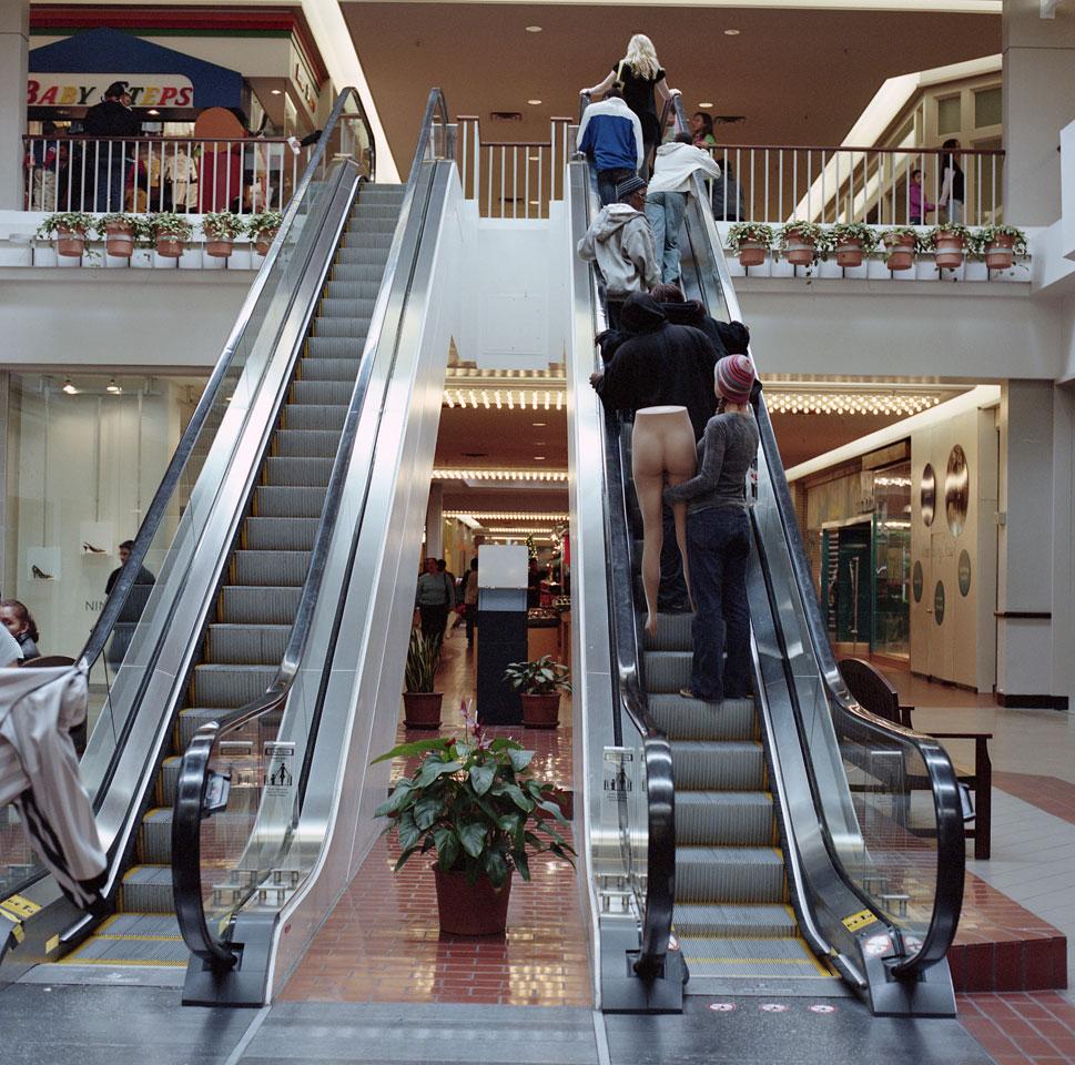 Mannequin on escalator