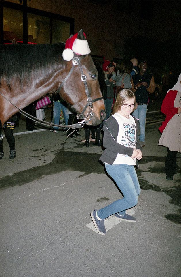 Police horse in santa hat